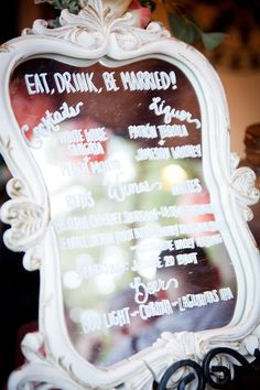 Stray from the traditional chalkboard menu and create your own mirrored cocktail menu! | Sarah Marcella Photography | TheKnot.com