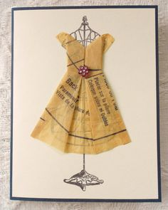This is a hand made card that measures 4.25 wide by 5.50 tall. The sweet little origami dress is made out of vintage a clothes pattern and is