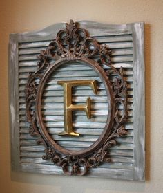 Nice idea of Framed initial or monogramon Old Window Shutters