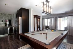 Brunswick pool table the Treviso with a Brunswick Centennial cue rack in the background from the property brothers show