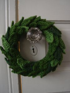 Christmas wreath made up of crocheted leaves.