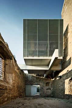 Wow! Concrete vs. ruins. Amazing contrast between old stone structure and new sharp concrete beams and louvres.