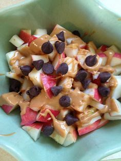Snack time. Just apples, melted peanut butter and chocolate chips. The BEST.