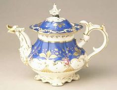 An ornately decorated porcelain teapot that is typical of the Rococo Revival of the 1830s-1840s. http://www.liverpoolmuseums.org.uk/walker/collections/craftdesign/design/rococo/teapot.aspx