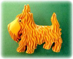 Highly carved butterscotch Bakelite Scottie dog pin