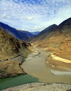 """""""The confluence of the Zanskar River (from top) and the Indus (bottom flowing from left to right) is 3 km southeast of Nimmu village in Ladakh, [a disputed territory between India and Pakistan]."""