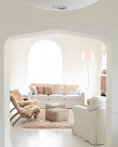 Shearling slipcovers and rugs bring a certain softness to this light and bright living room.