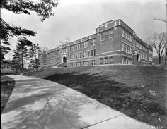 David Milliard Junior High, at the corner of Oak Street and College Ave (near where the SECU building is now). This was Asheville High School from 1916 until 1928, when the current Asheville High School building was completed. Converted into David Milliard Jr High in 1928, and from 1934-40, also housed Asheville-Biltmore College, which would later become AB-Tech.