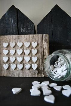 Inspiration only... mini concrete hearts on weathered wood.