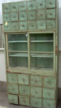GREEN PAINTED PINE CHEMISTS CABINET 19th c.