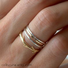 Thin silver and gold stacking bands by Colby June Jewelry. Beautiful!
