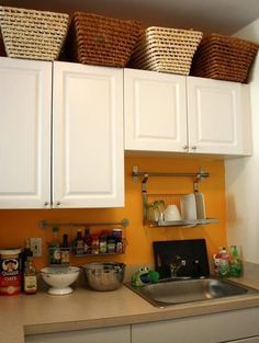 excellent use of limited space in a studio kitchen: grundtal dish and spice racks, wicker baskets above cabinets