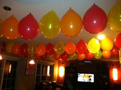 Balloon garland in coordinating red, orange and yellow party colors