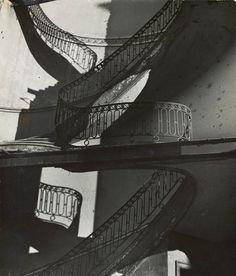 Stair dreams.- Bill Brandt. Bombed Regency Staircase, Upper Brook Street, Mayfair. c. 1942