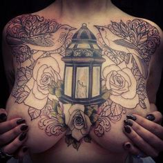 Amazing placement for this lantern and candle combo. #InkedGirl #InkedMagazine #chesttattoo #tattoos #inked #ink #art #flower