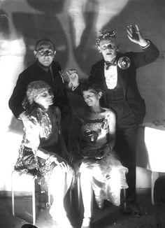Gunta Stölzl & Tut Schlemmer. Behind: Walter Beck & Oskar Schlemmer. Bauhaus party, 1926.