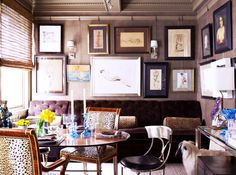 Step into a Whimsical Apartment with Sophisticated Style// gallery wall, tufted banquette