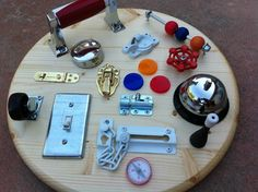 Deluxe Toddler Busy Board. (how things work...) @Jordan Bromley Michel - made me think of Hunter and his locks