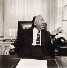 Alfred Hitchcock in his office at Universal Studios, 1957