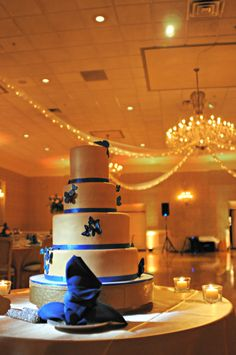 gold wedding cake, butterfly wedding cake, blue wedding cake, modern wedding cake.