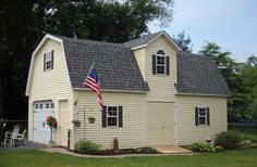 Two-story Barn from Sheds Unlimited Inc in Lancaster PA. A lovely building with a fashionable dormer with a roundtop glass window. There are countless options available on such buildings so call 717-442-3281 today to find out more.