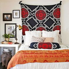 Red and orange accents bring a cozy autumn feel to this exotic bedroom. More cozy color schemes: http://www.bhg.com/decorating/color/schemes/cozy-color-schemes-for-every-room/?socsrc=bhgpin092413bedroom#page=5