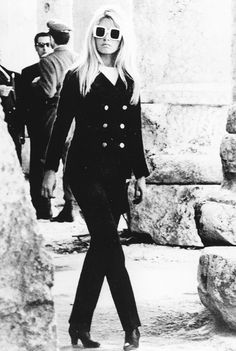 Brigitte Bardot in Yves Saint Laurent sunglasses and a peacoat.