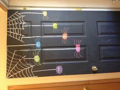 Chalkboard painted front door decorated for Halloween.