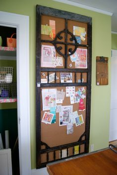 Old screen door frame backed with cork becomes a beautiful Inspiration Board permanently affixed to the wall. Love!! Bachman's Spring Idea House idea, pantry doors, old screen doors, pin boards, cork boards, bulletin boards, screens, old doors, door frames