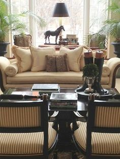 Equestrian decor and a great layout. Ignore chair fabric.  I like the riding boots on a tray :)