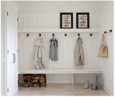 Mud room. Board and batten walls, bench, hooks, shelf, tile floor