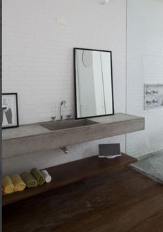 Bathroom inspo: Concrete, wood, mirror, and glass
