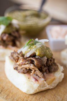 Slow-Roasted Pork Carnitas Sliders with Homemade Salsa Verde, Fresh Cilantro, Onion, and Chipotle Mayo