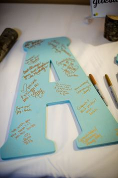 Have guests write their well wishes on large wooden initials. What a fun idea! /// Photo by Gray Photography via Project Wedding.... I know it is says wedding but this would be cute for a baby shower too. Just to show the lil one how much they are loved even before they were born