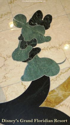 Minnie Mouse inlay (small) in the marble floor in the lobby at Disney's Grand Floridian Resort.   There is a larger Minnie Mouse featured in another area of the lobby floor.  For more resort photos, see: http://www.buildabettermousetrip.com/disneys-grand-floridian   #Minnie Mouse #GrandFloridian #Disneyworld #WDW