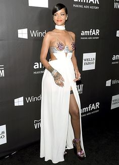 Rihanna wore a sexy cleavage-baring dress to the 2014 amFar Gala in Los Angeles.