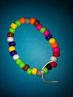 Pi Day bracelets .  Basically, you assign a bead color to a number and the kids recreate the number Pi into an awesome bracelet.