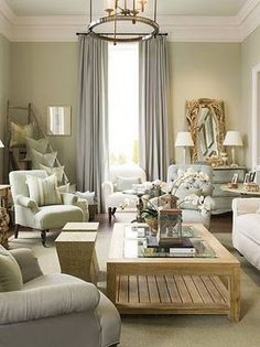 A beautiful #beachy living room in pale green, blue and cream. Lots of comfy chairs and sofas to relax in!