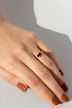 14k yellow gold vermeil ring set with a jet black Swarovski crystal baguette. Happy to be stacked. Vermeil is sterling silver plated in 14k gold. Made in NYC.