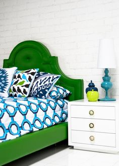 Kelly Green headboard mixed with turquoise and blues, fun combination
