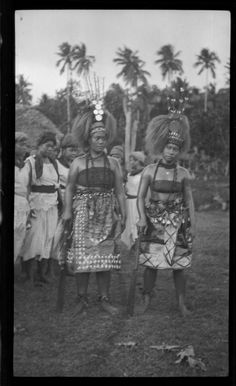 Group of women, the two in front wearing traditional Samoan clothing and headdress. Creator/Contributor: Lambert, Sylvester Maxwell, 1882-1947, Photographer Date:between 1919 and 1939 Contributing Institution: UC San Diego, Mandeville Special Collections Library