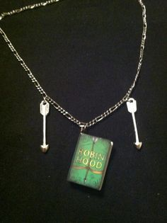 "Robin Hood book necklace On 16"" silver coloured chain Arrow charms $14"