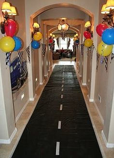 This is an awesome idea for a birthday party. Cars party or Hot Wheels party - use a black plastic table cloth and add white lines to make a highway - car theme.