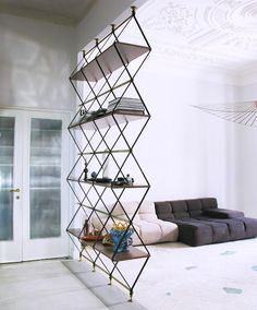 decor, interior design, storage rooms, library design, storage shelves, pietro russo, couches, diamond shapes, room dividers