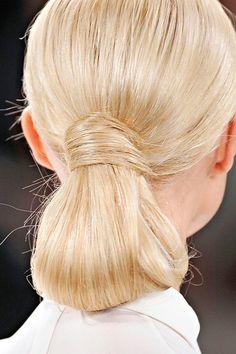 chic- half bun half ponytail