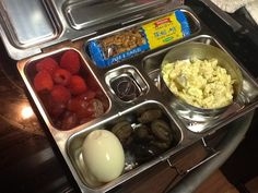 Boiled egg, olives, raspberries, grapes, trail bar, and Fauxtato salad