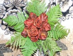 Roses made of fall leaves! Gona try this in the fall.