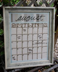 Love this Dry Erase Perpetual Calendar. Stitched and framed fabric, trimmed with grosgrain ribbon and framed. Dry erase markers used directly on glass -- they wipe completely clean. This calendar available via Etsy.