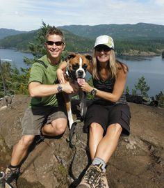 Greg McWillam and his wife Lynn Melanson rest with their dog Bella after hiking to Ripple Rock, overlooking Seymour Narrows on Vancouver Island, Canada. Greg wears his 50th Anniversary Limited Edition James Bond Omega Seamaster calibre 2507, while Lynn wears her Technomarine Cruise.
