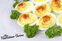 Skinny Deviled Eggs! | Insanely delish and satisfying weight loss snack for just 88 calories-- they'll squash your hunger! | For MORE RECIPES please sign up for our FREE NEWSLETTER www.NutritionTwins.com